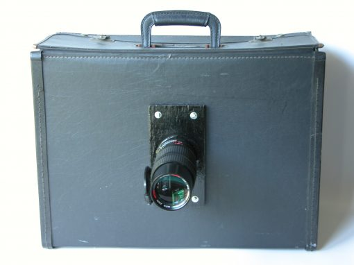 #943 Telephoto Lens on Black Satchel