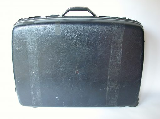 #132 Black Plastic Suitcase w/Tape Marks / Chronicle Hotel #2, SF