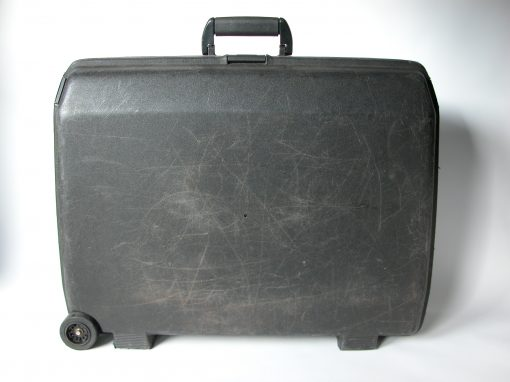 #136 Black Plastic Suitcase w/Wheels / Alkain Hotel, SF