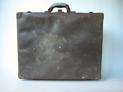 #112 Brown, Crinkly Surfaced Suitcase w/Thick Leather Handle / Motel In Gas Station, Lebanon, MO