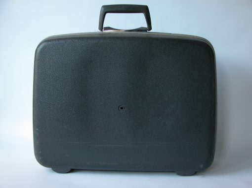 #125 Black Plastic Suitcase w/Black Plastic Handle /Hotel Essex, SF