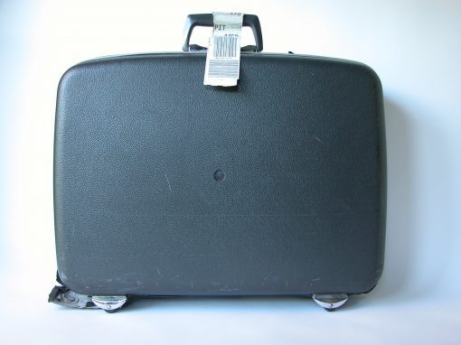 #529 Black Plastic Suitcase w/Wheels / Rochester Falls