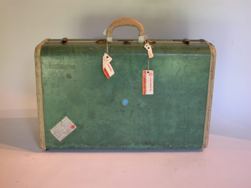 #30 Green Samsonite Suitcase (sent to Sri Lanka) / Traveler's Hotel, Oakland, CA