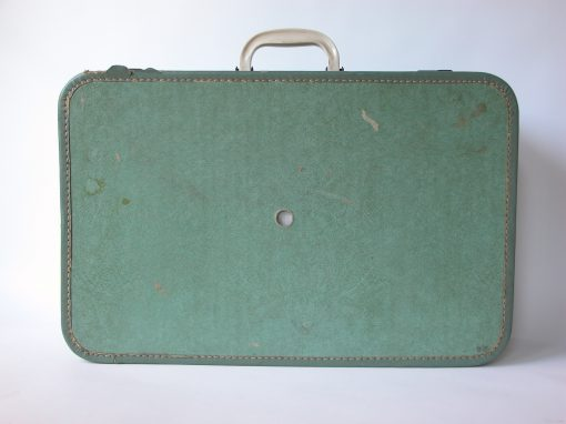 #103 Green Paper Suitcase w/White Handle / Hotel Travelers, Oakland, CA