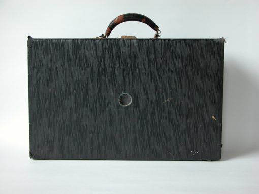 #105 Black, Antique Suitcase w/Leather Handle / Hotel Sutter, Oakland, CA