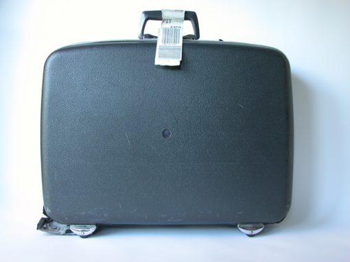 #531 Black Plastic Suitcase w/4 Wheels & Tag / Go Go Corner Market & Hotel